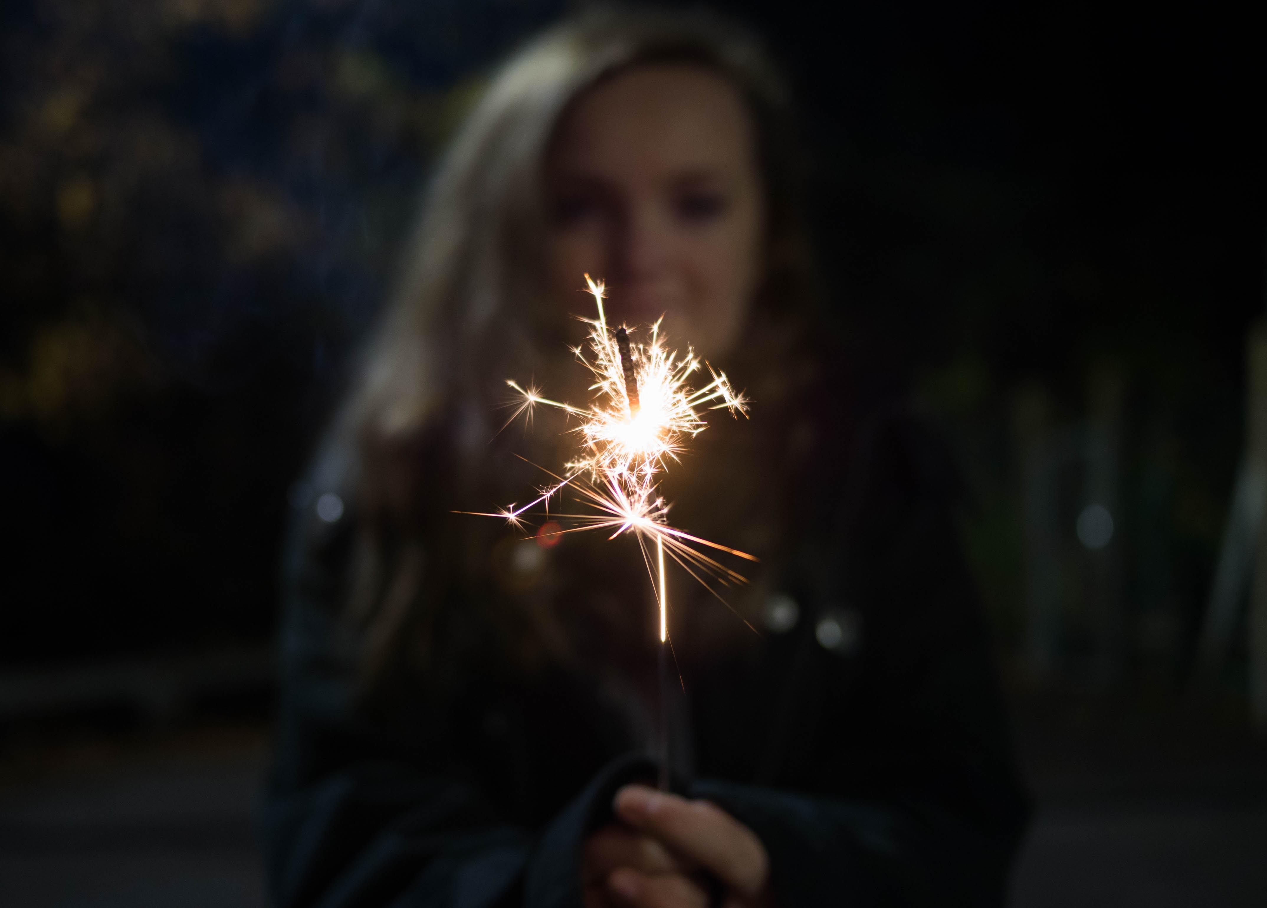 woman holding sparkler