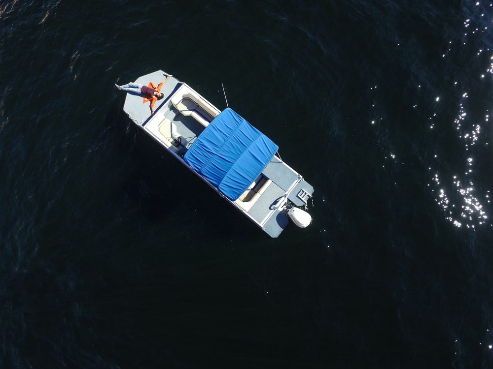 aerial photo of gray boat on body of water