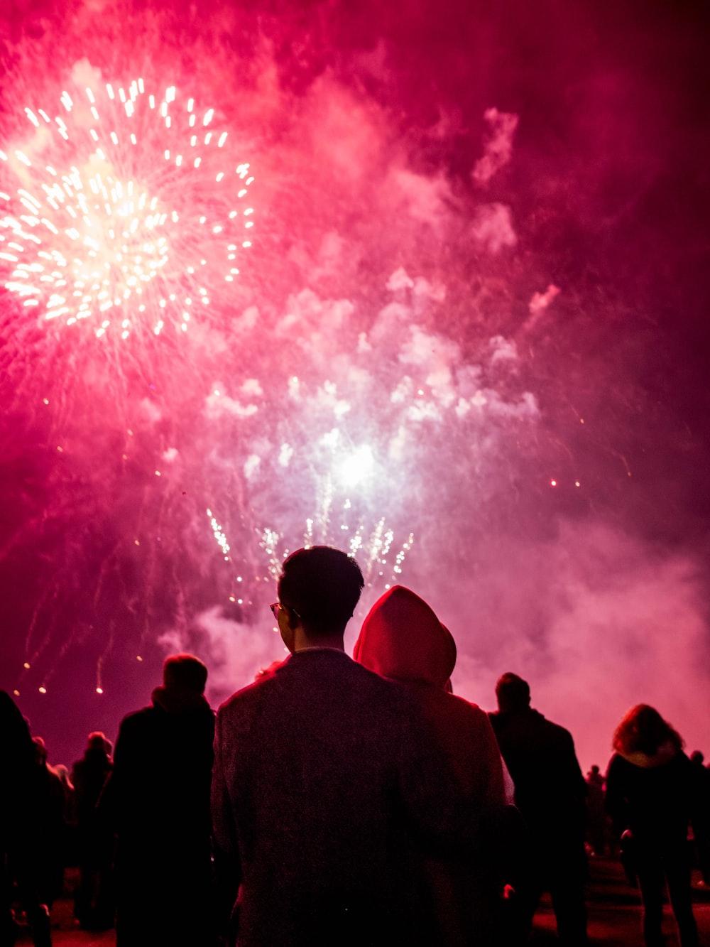 people watching fireworks during nighttime
