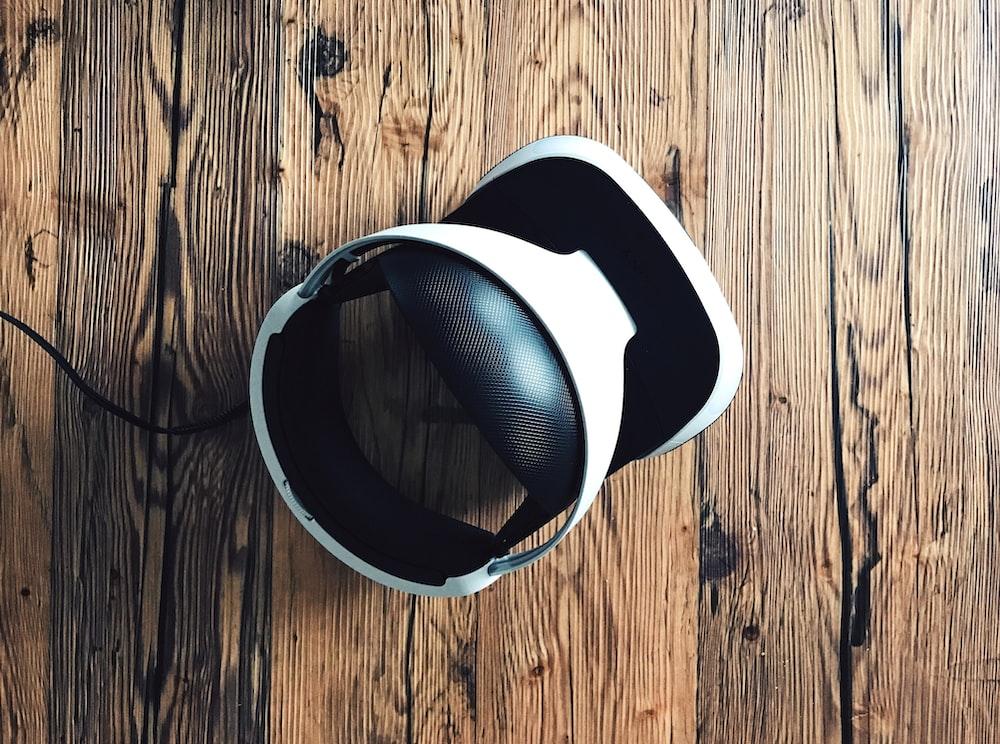 white and black Bluetooth headphones