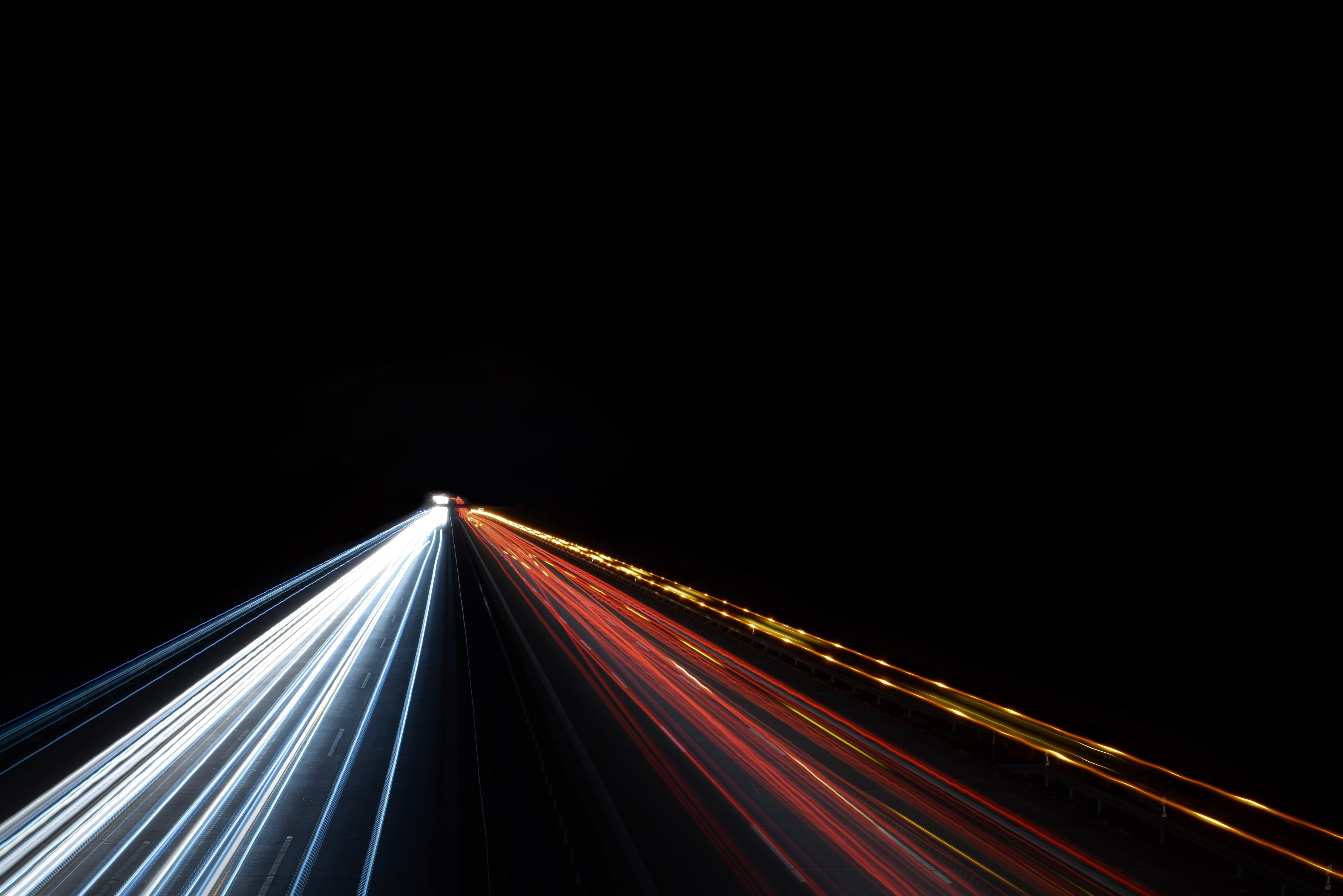 low exposure photo of cars on road during night time