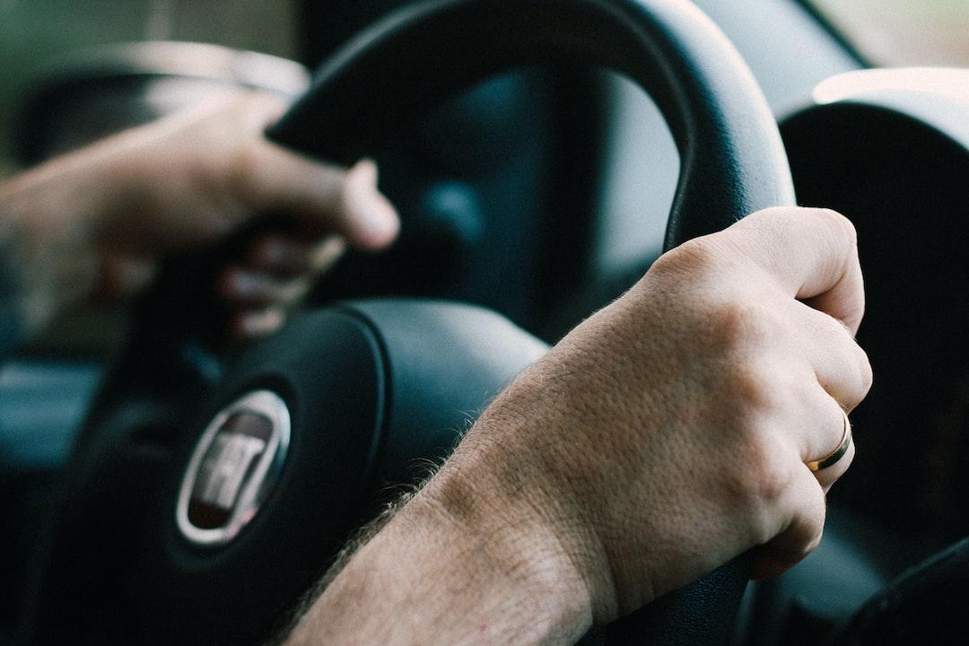 man driving Fiat car