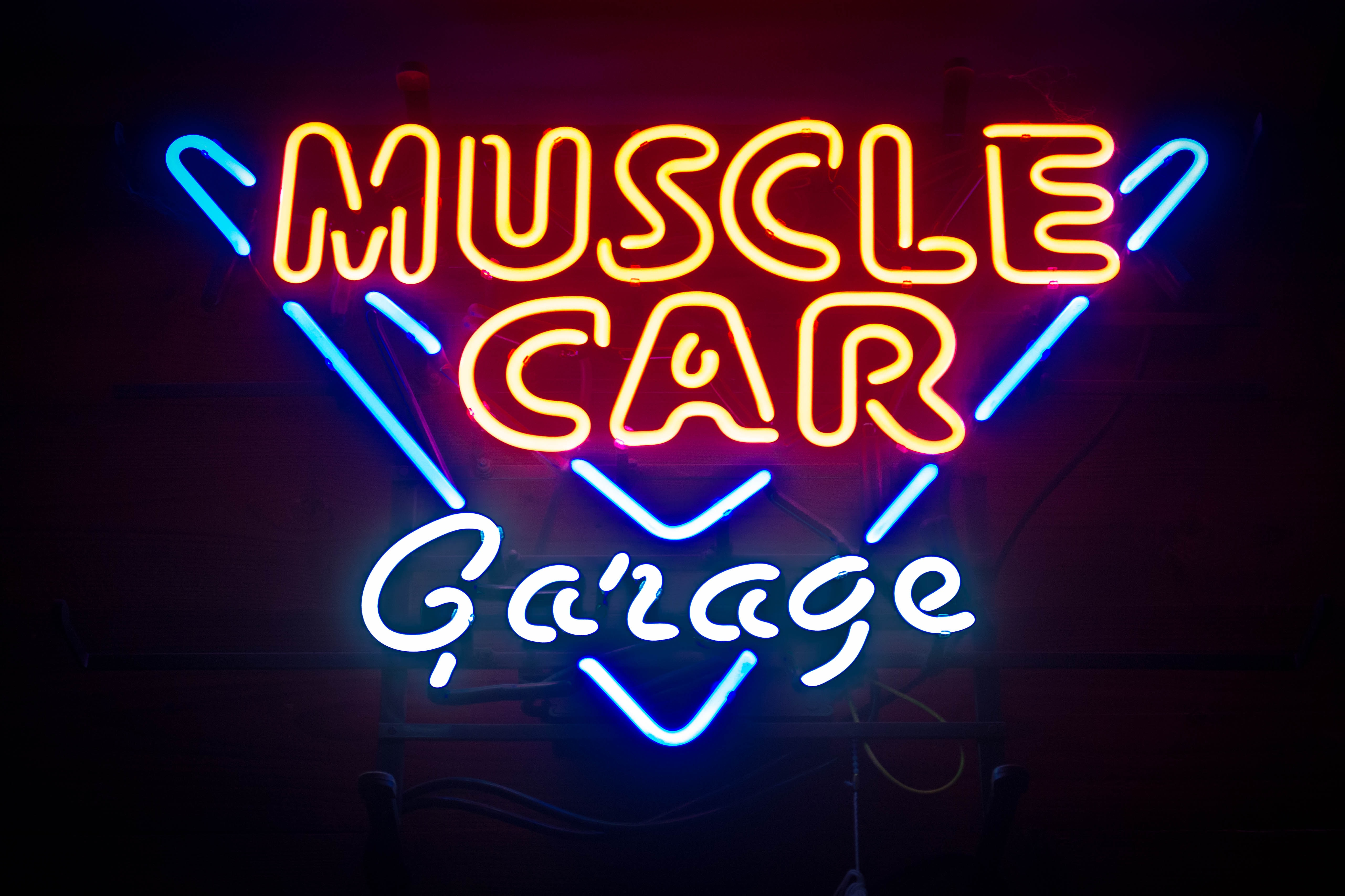 Blue And Red Neon Sign For A Muscle Car Garage Seen At Night