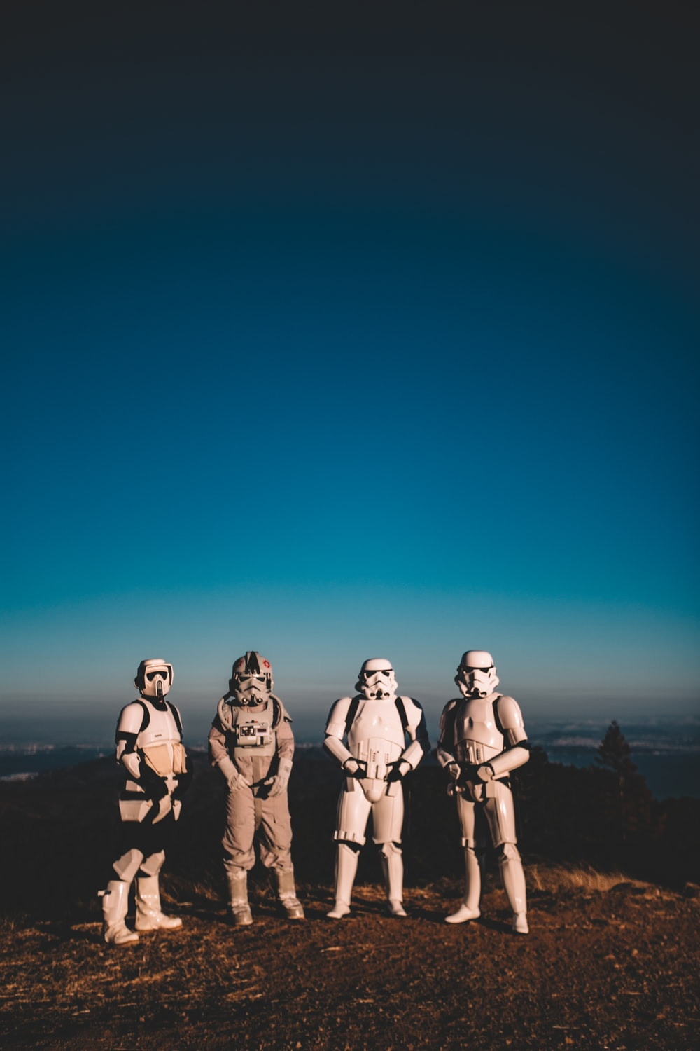 four person wearing Star Wars Clone Trooper costumes