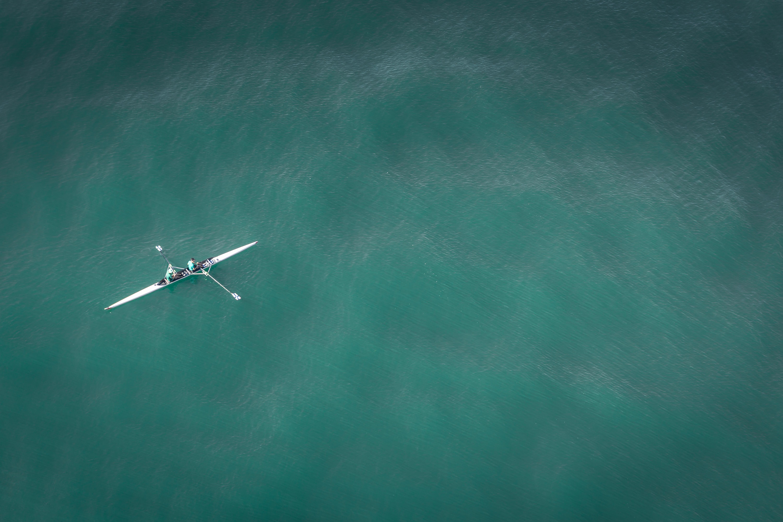 white canoe on body of water