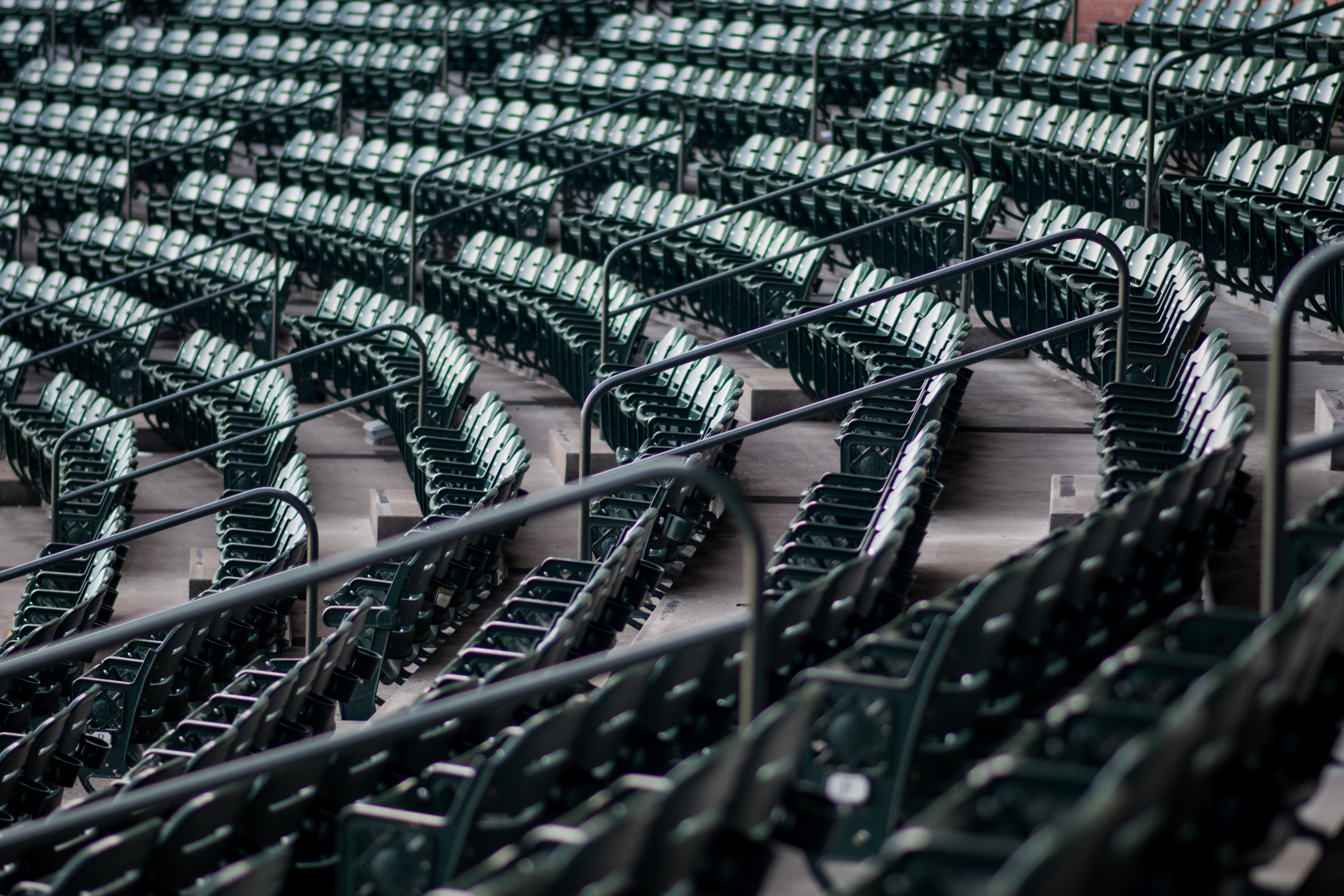 Set of seats in a stadium arranged with railing