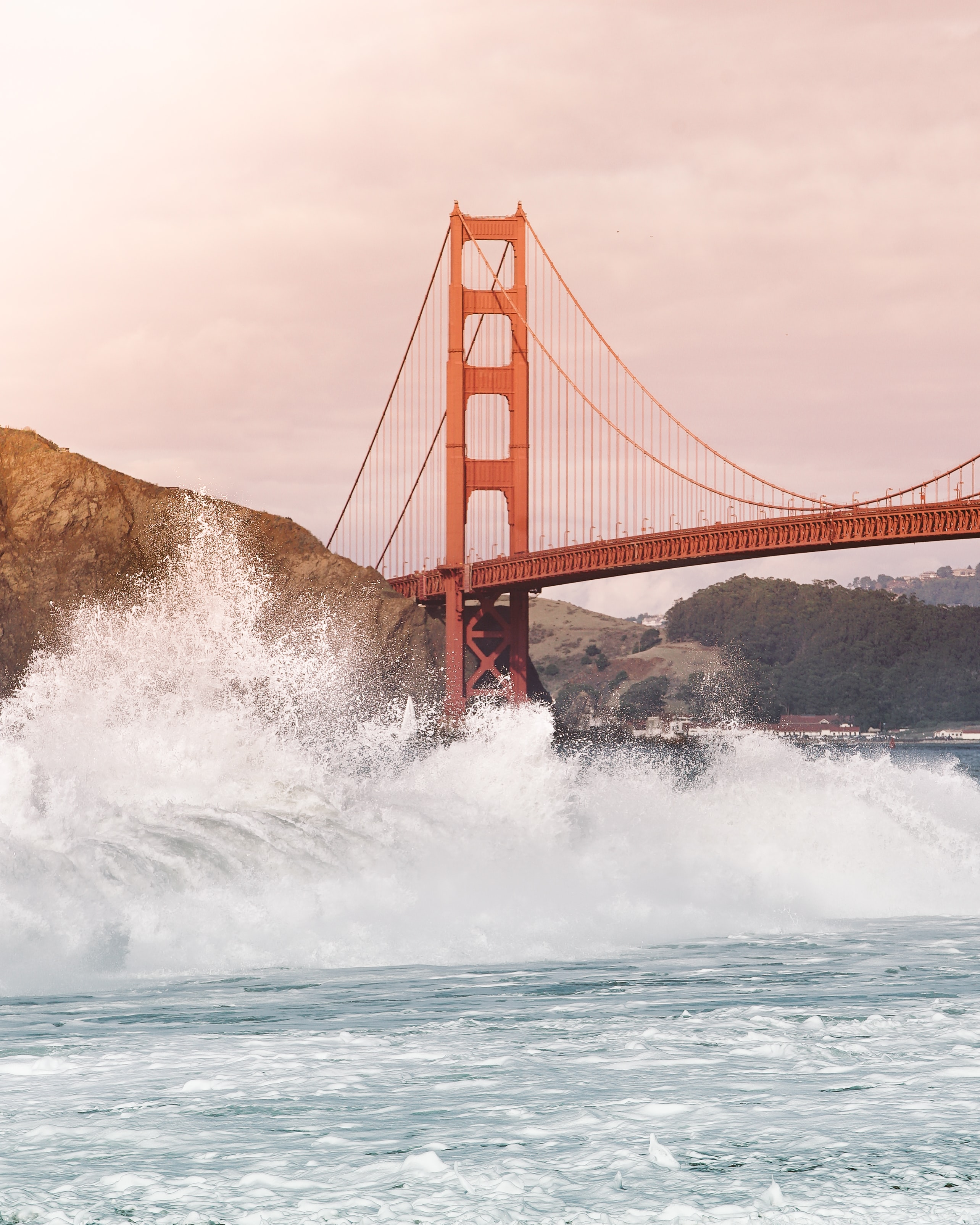 Large waves splashing near the Golden Gate bridge at Baker Beach