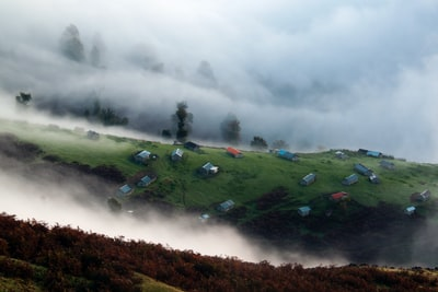 houses surrounded by fog iran teams background