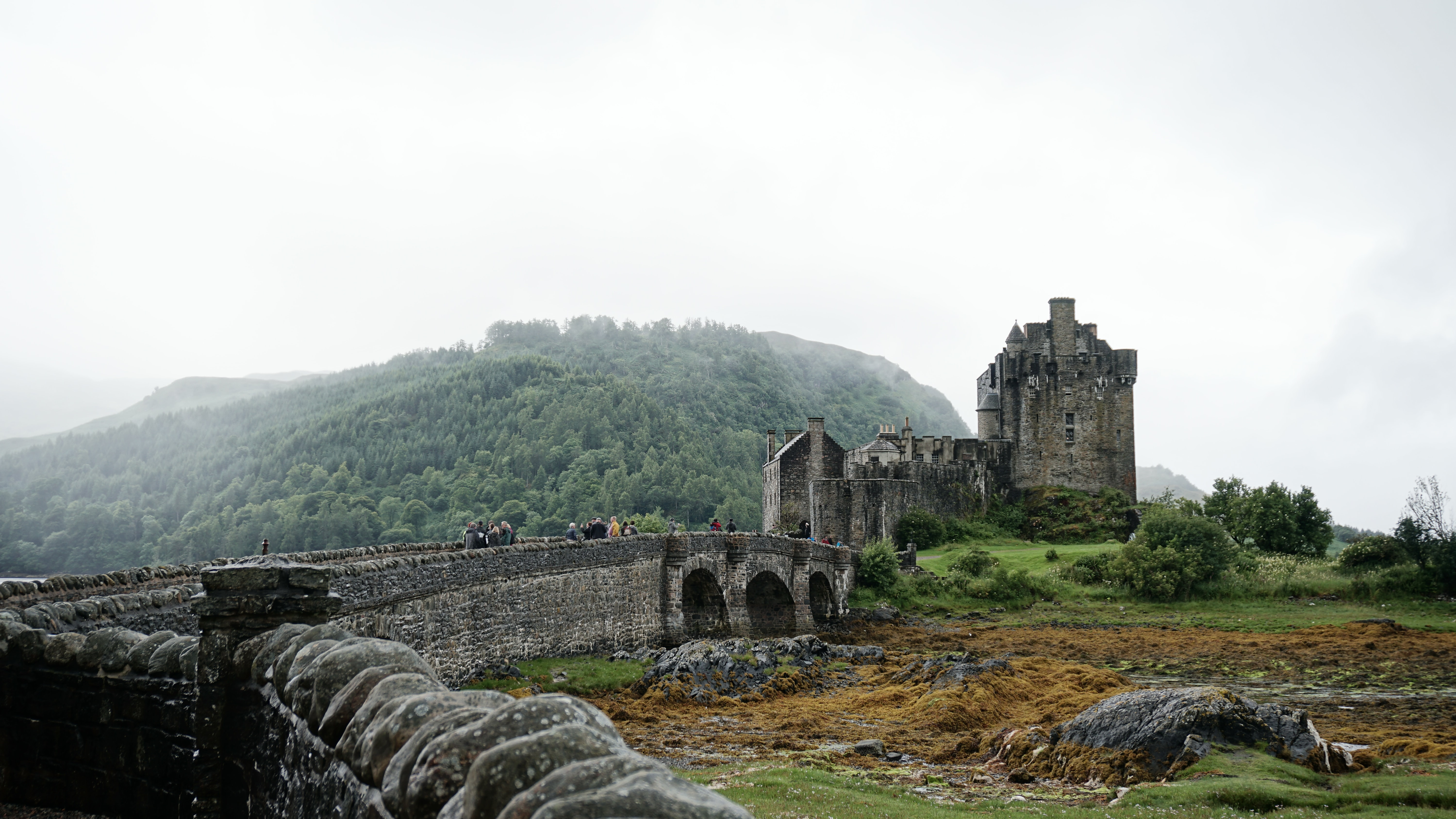 People walking on the walls of a medieval castle in Scotland