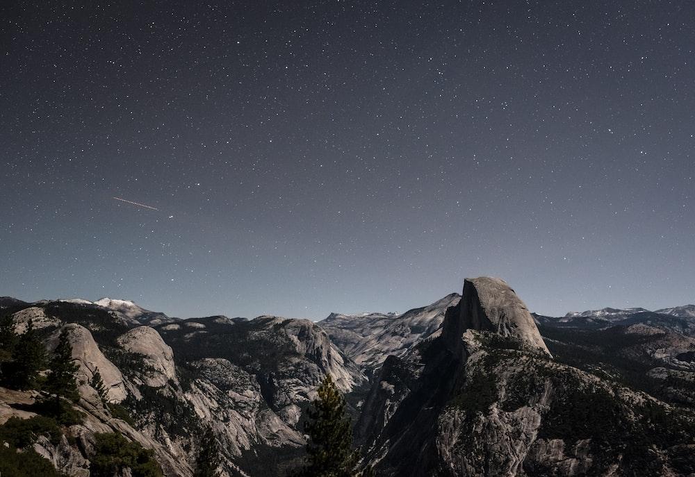 gray stone mountain at nighttime