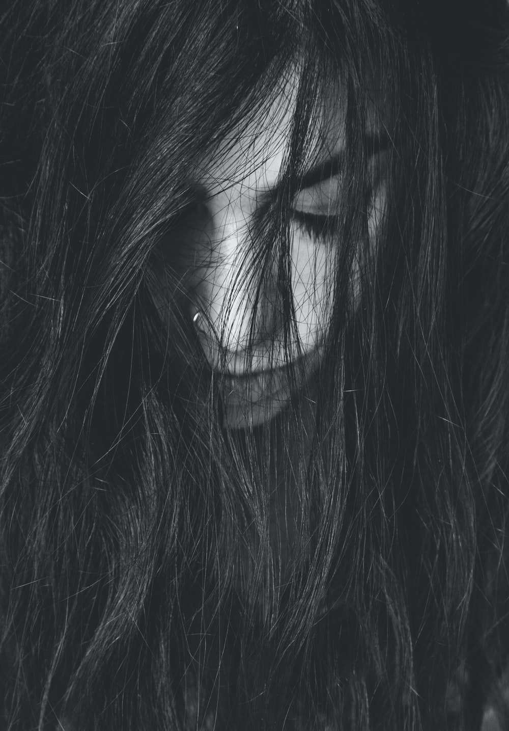 grayscale photography of woman looking down