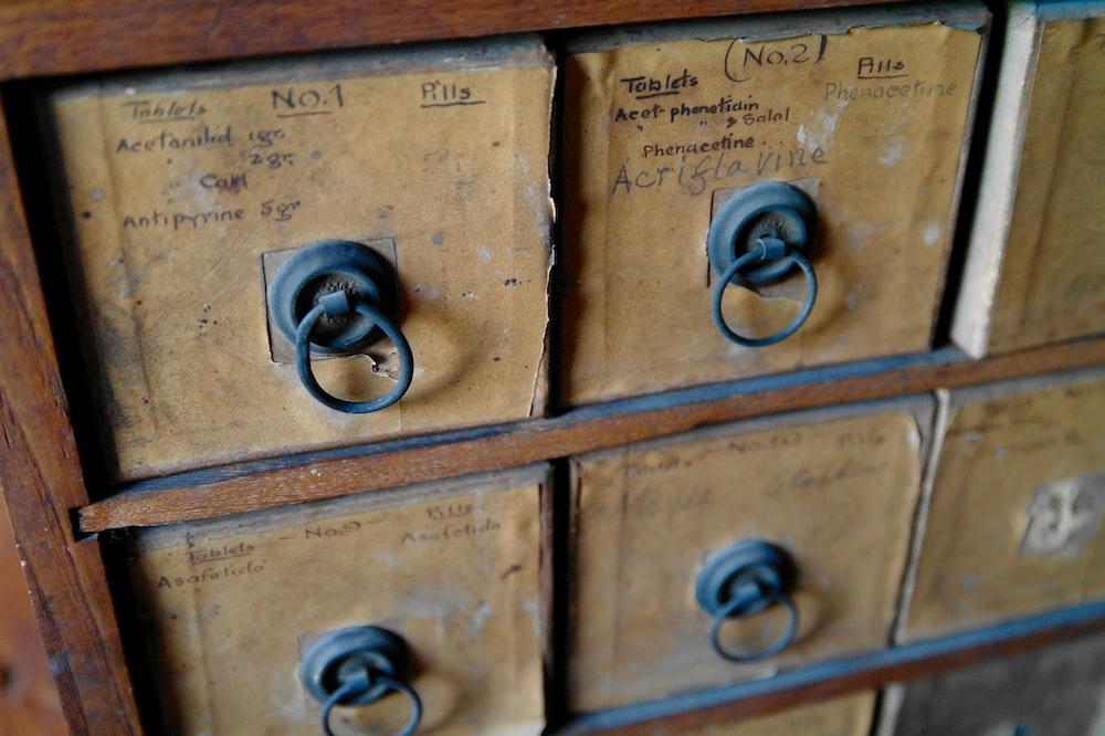 close shot of brown wooden drawer