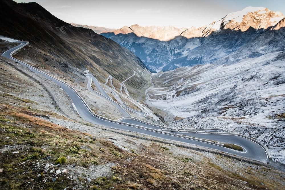gray asphalt road on mountain