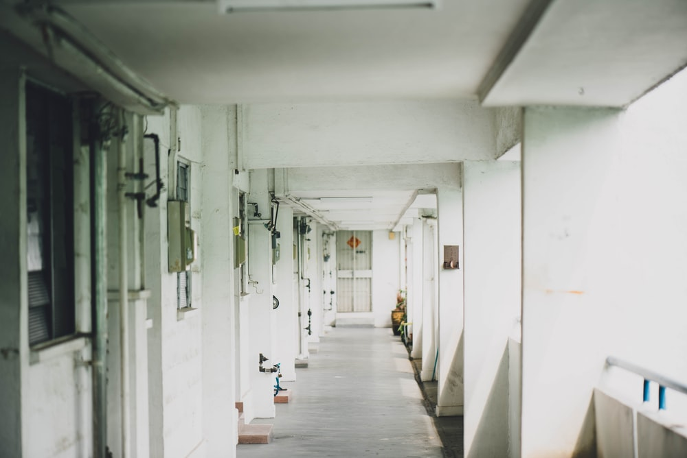 hallway of building with rails