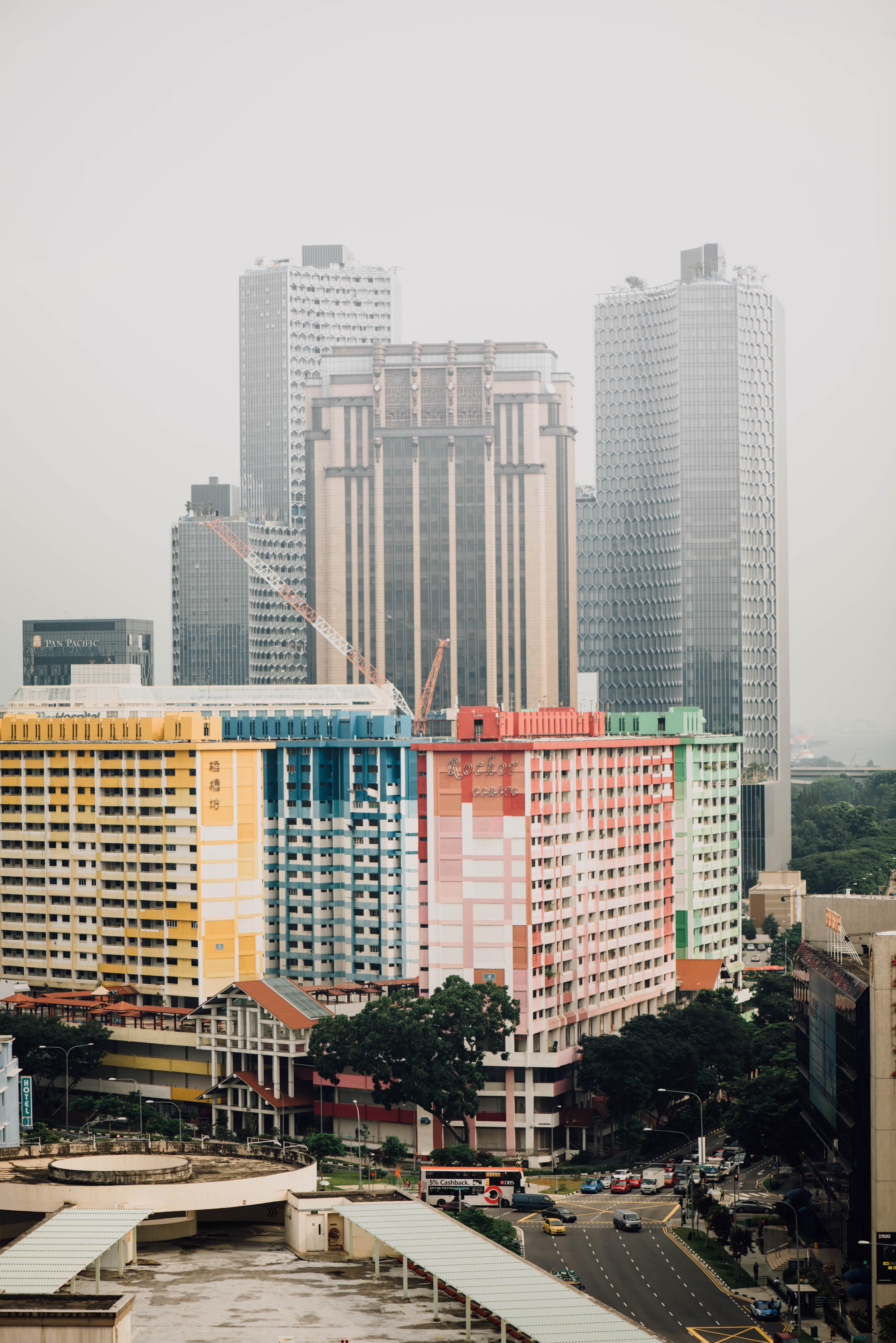 multicolored concrete high rise building near water