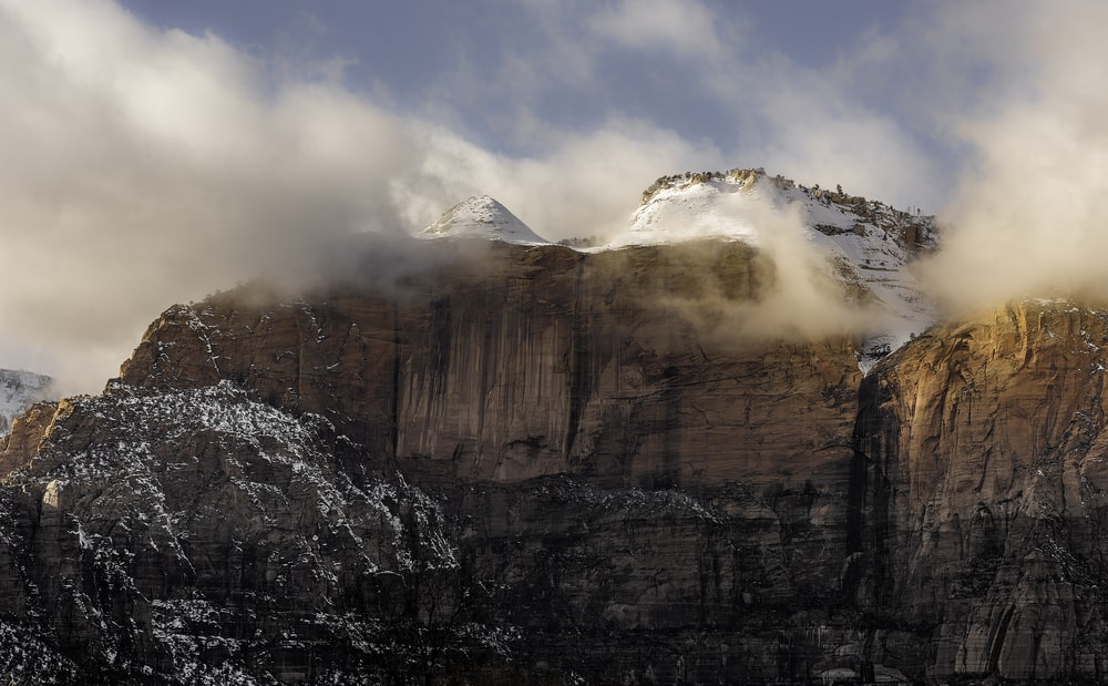 white covered rock mountains under white sky