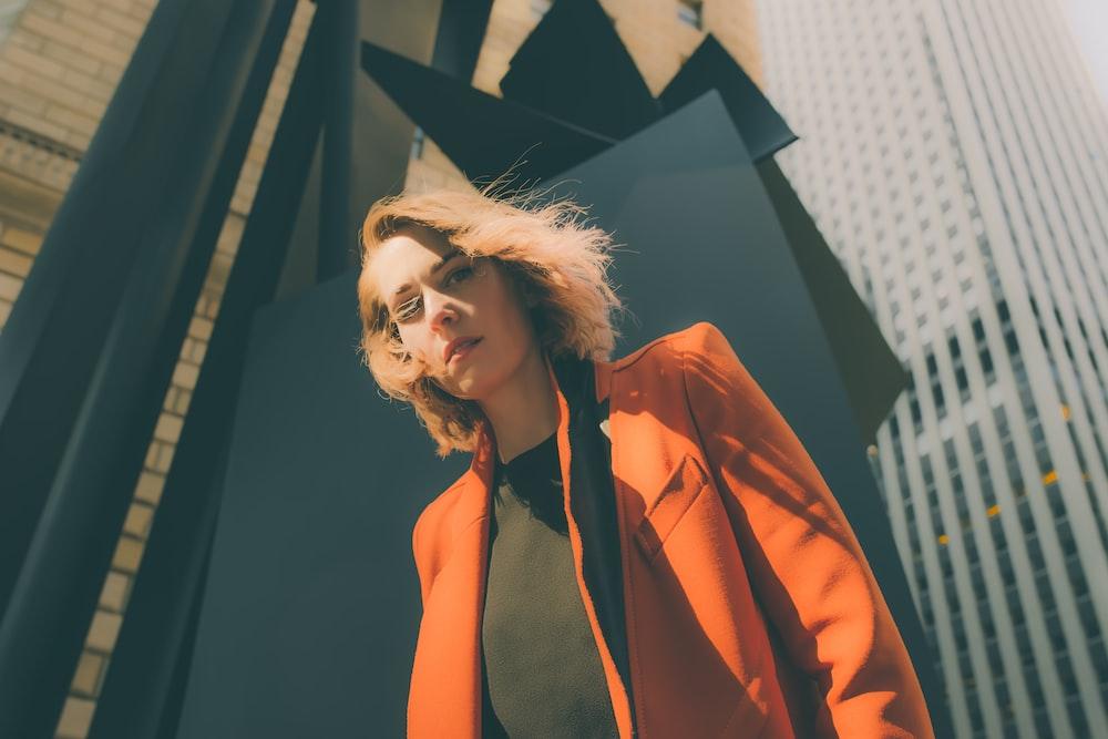 woman in orange suit jacket