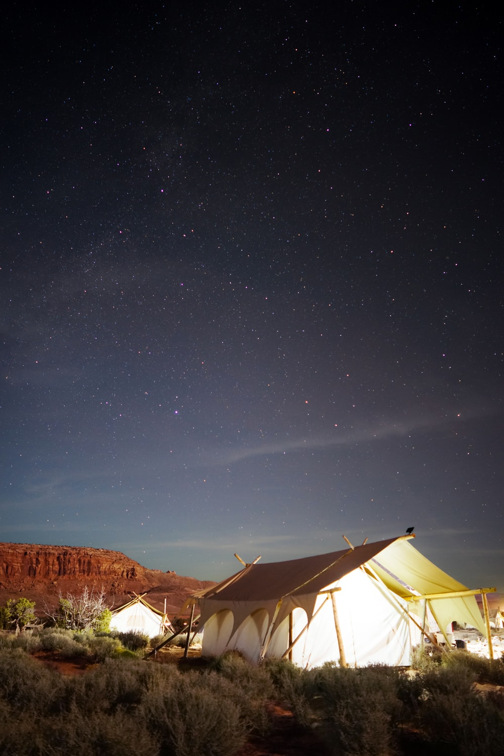 white cabin tent on open field during nighttime