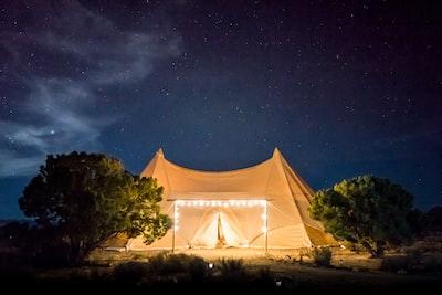 beige tent under starry skies tent teams background