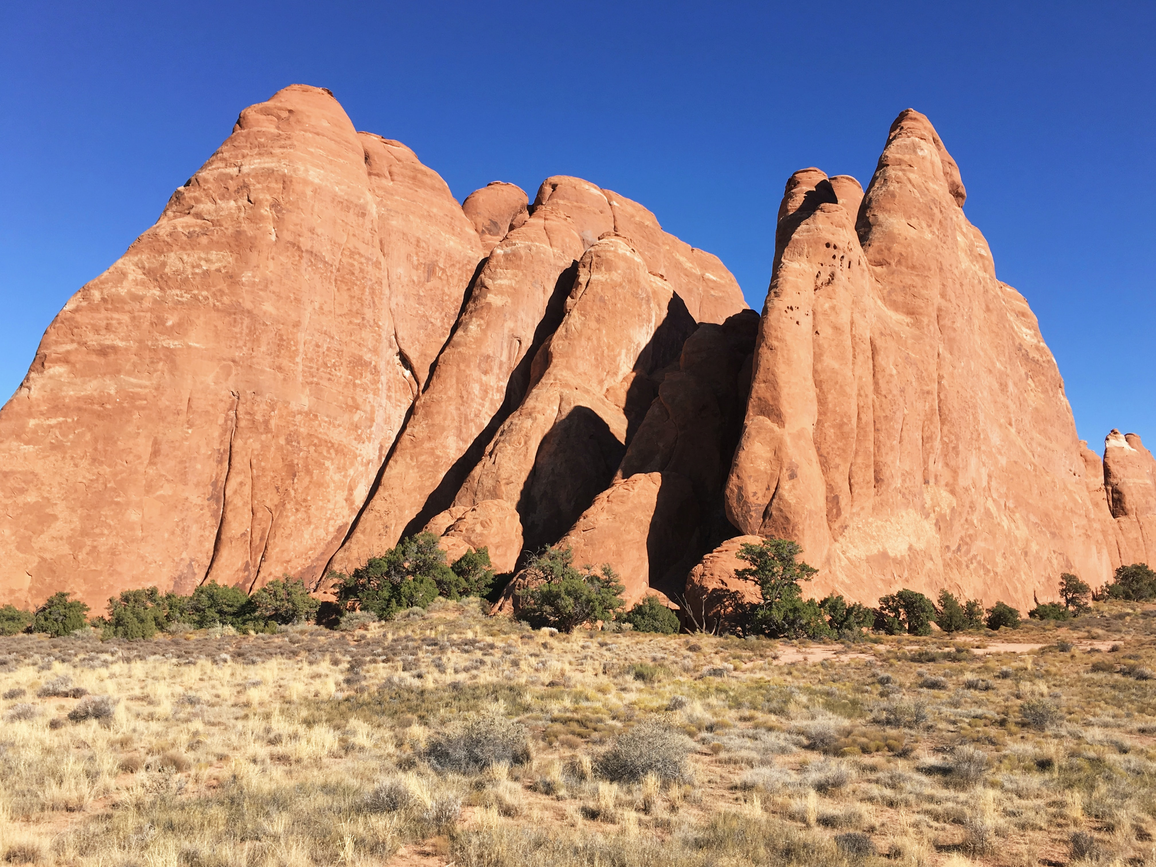 Red rock outcroppings against blue sky