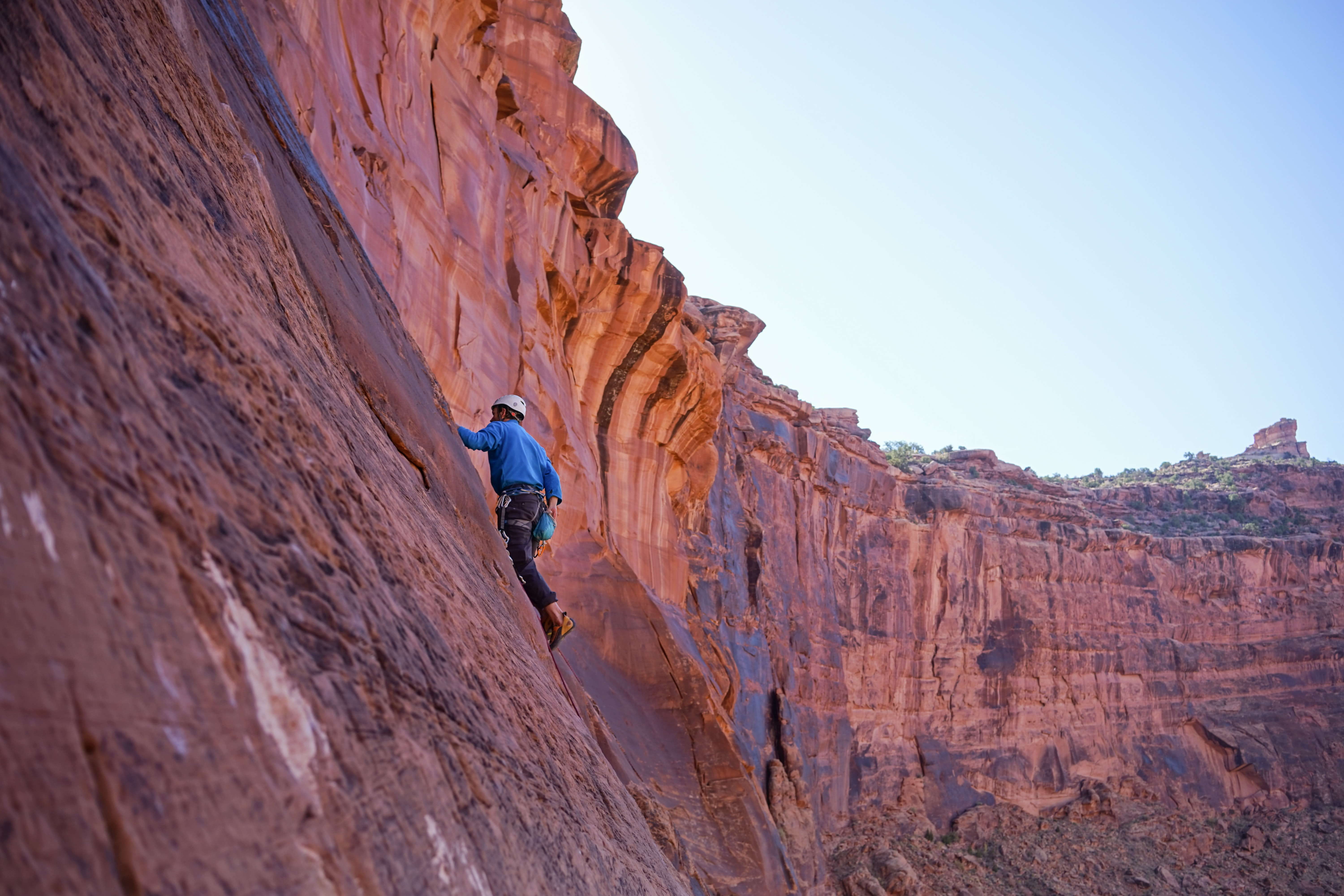 Extreme climber scales the side of a rocky mountain
