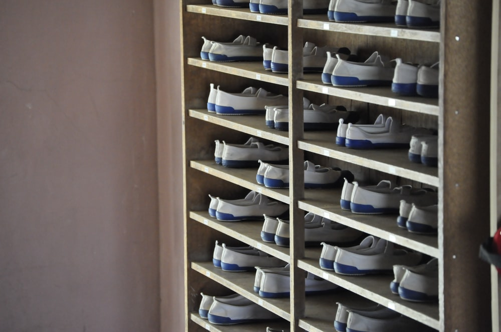 white and blue shoes in rack inside room