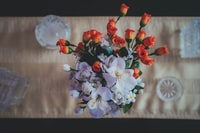 orange and white flowers on the table