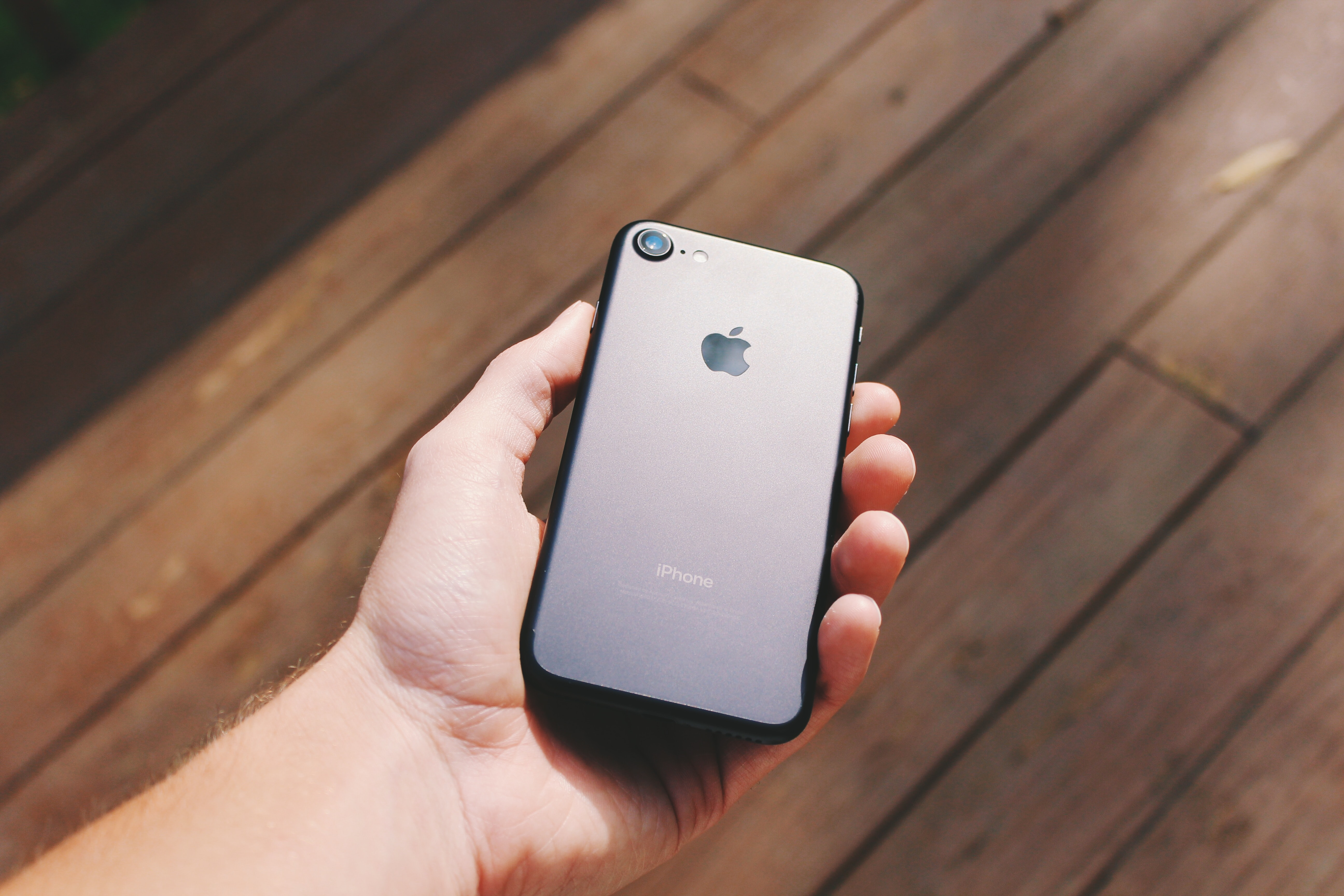 person holding jet black iPhone 7