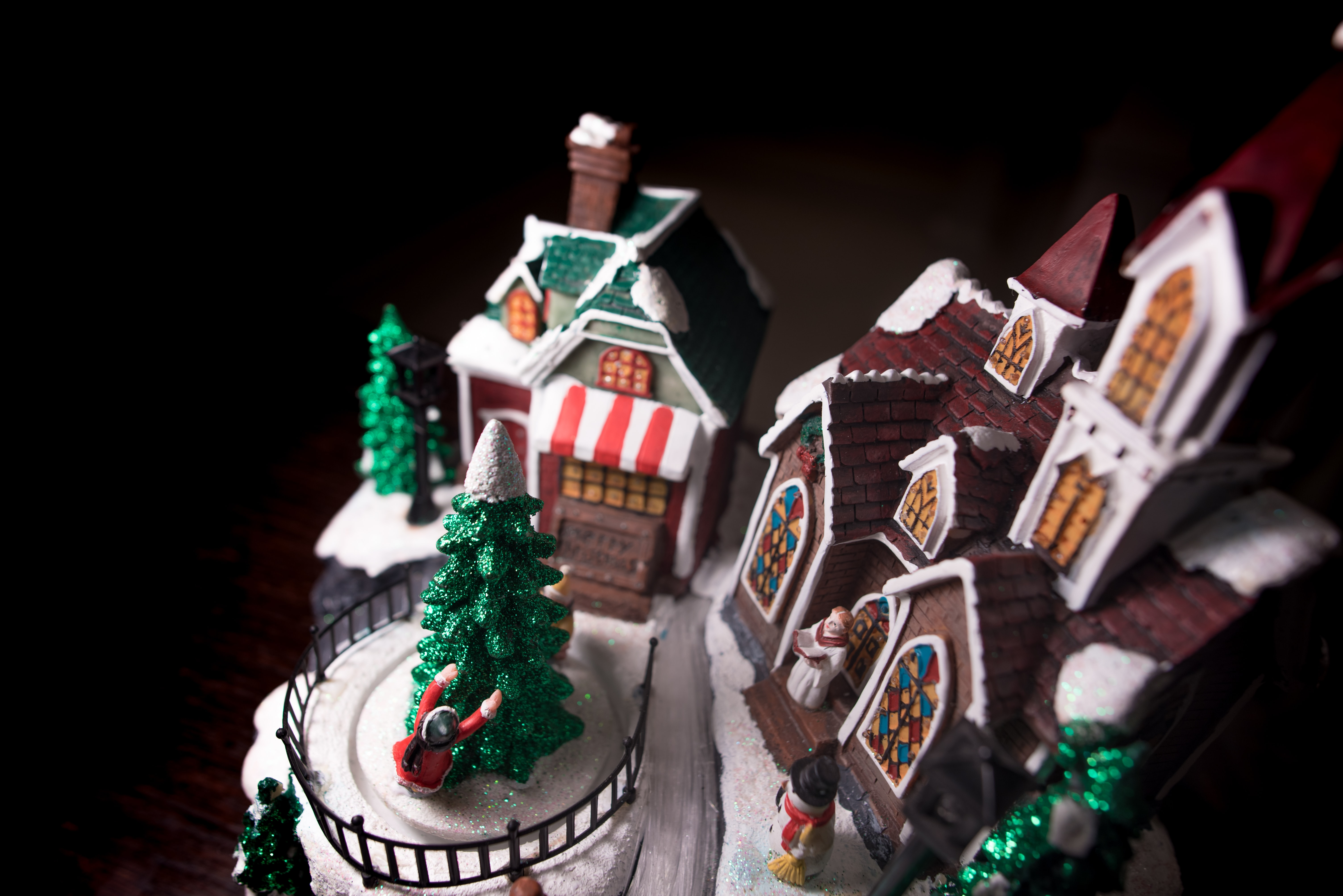 A model of the Christmas holiday replete with church, Christmas tree, snowman, house and people