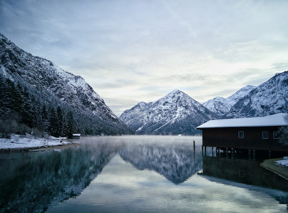 residence house in water surrounding mountain