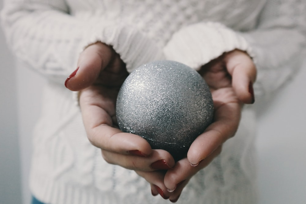 woman holding gray bath bomb