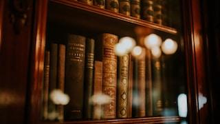 books in glass bookcase