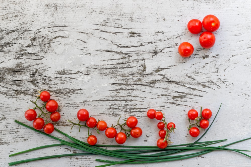 red citrus berries on gray surface
