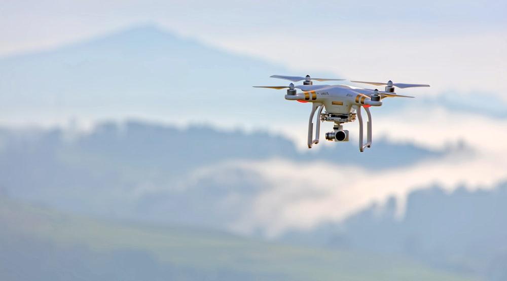 shallow focus photo of white quadcopter