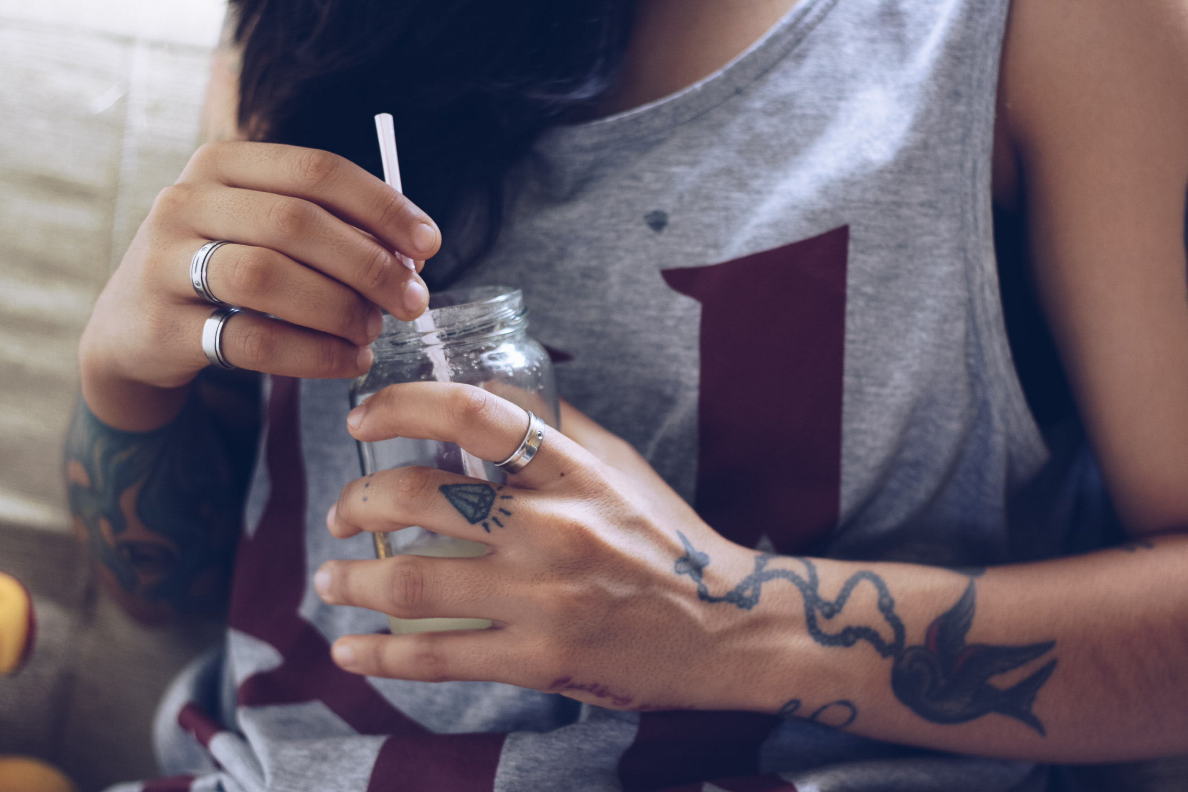 woman sitting holding bottle
