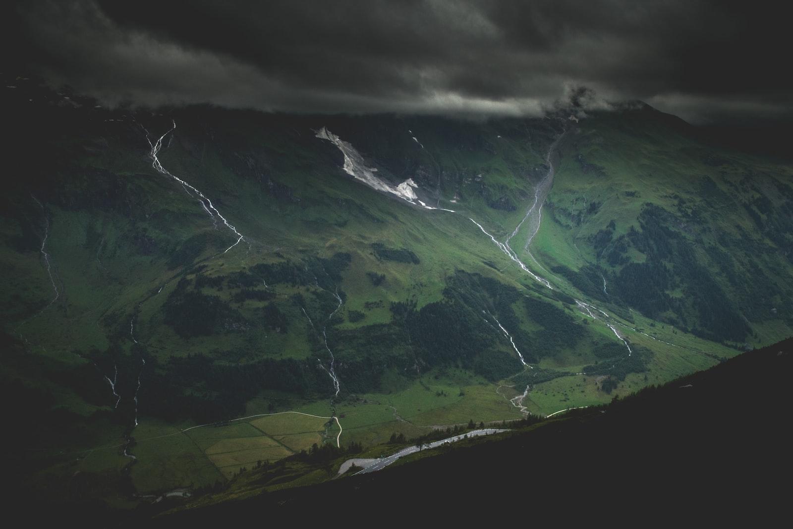 green mountain under dark