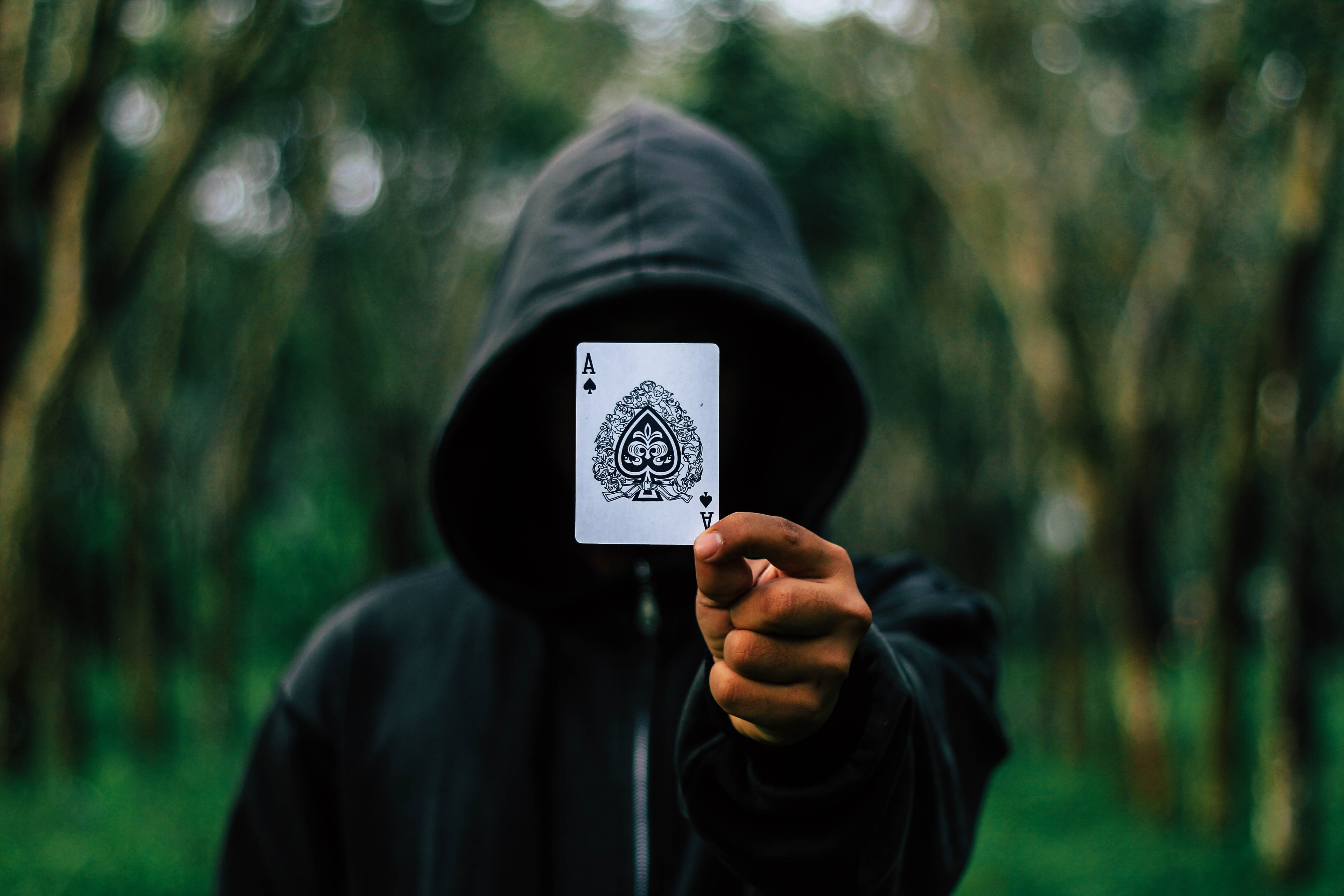man holding Ace of Spade card