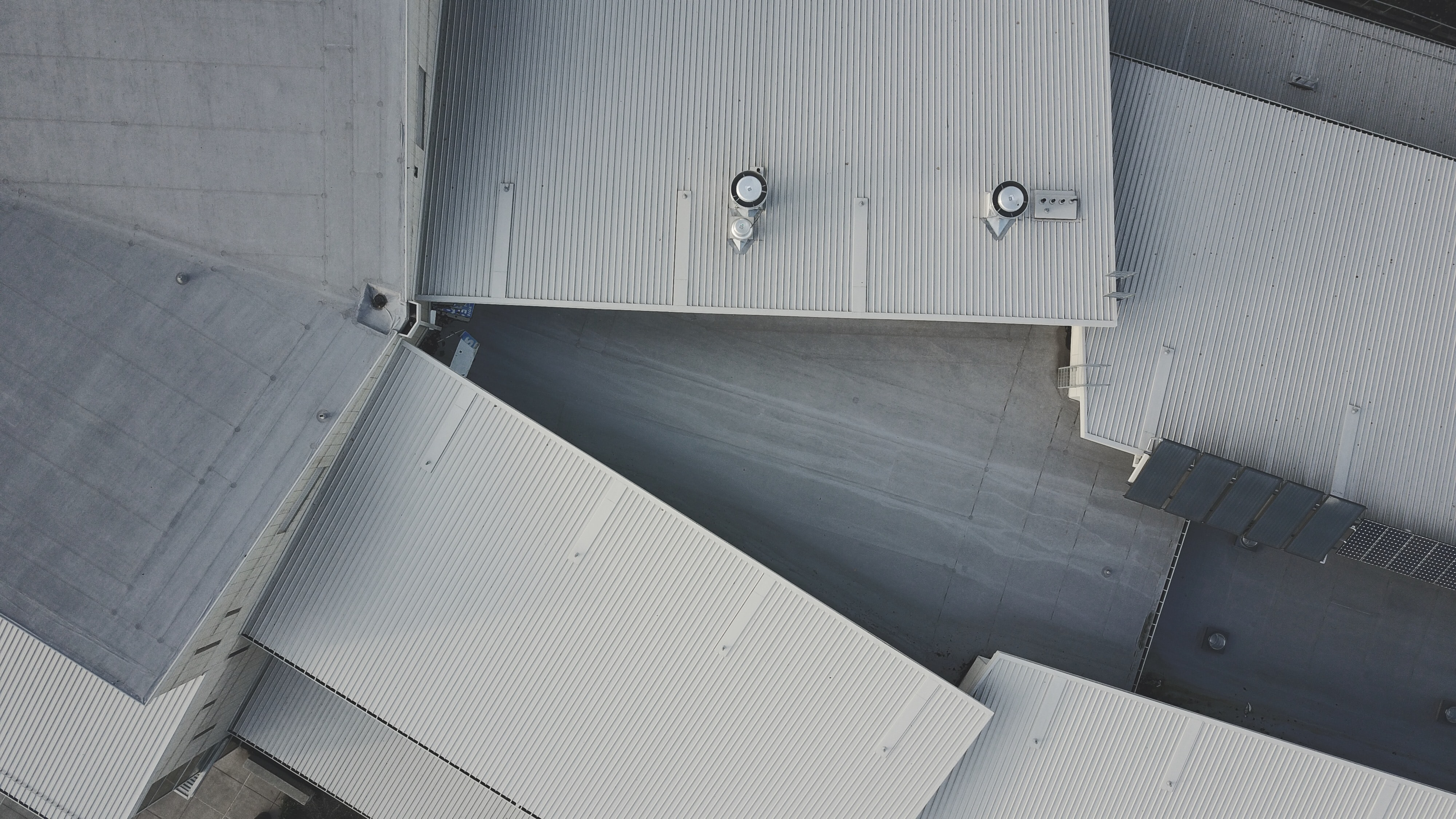 A drone shot of white industrial buildings
