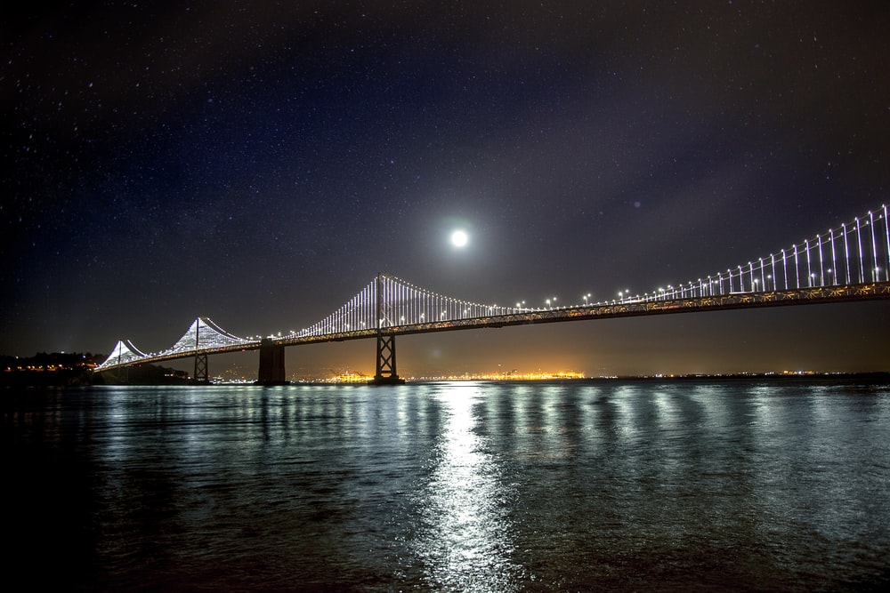 Moon over the San Francisco – Oakland Bay suspension Bridge reflected on the water below
