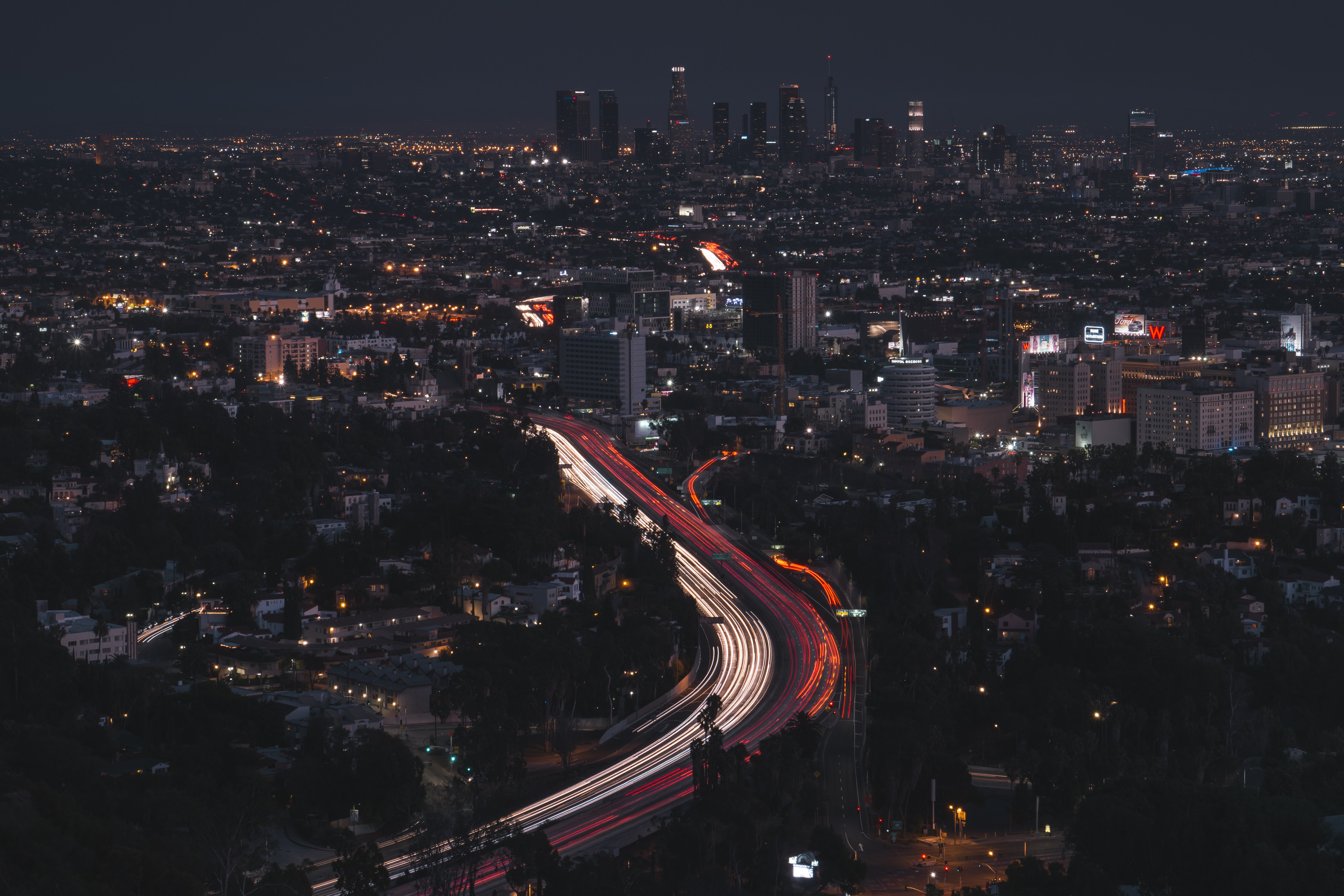 Long exposure of Los Angeles traffic at night with skyline