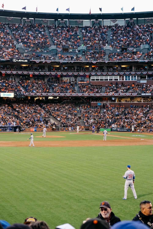 photo of baseball players in stadium during daytime