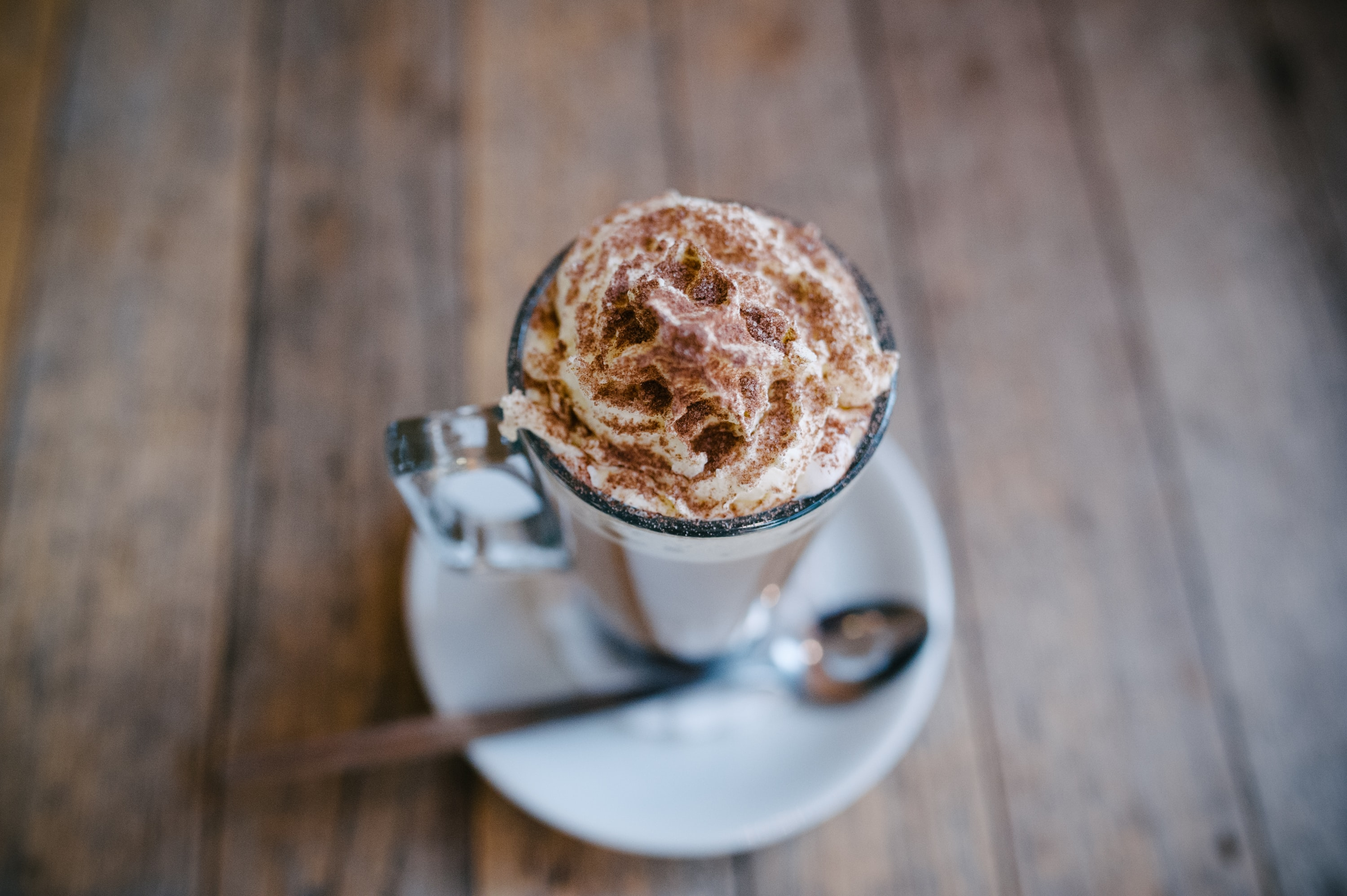 brown whip cream in clear glass cup