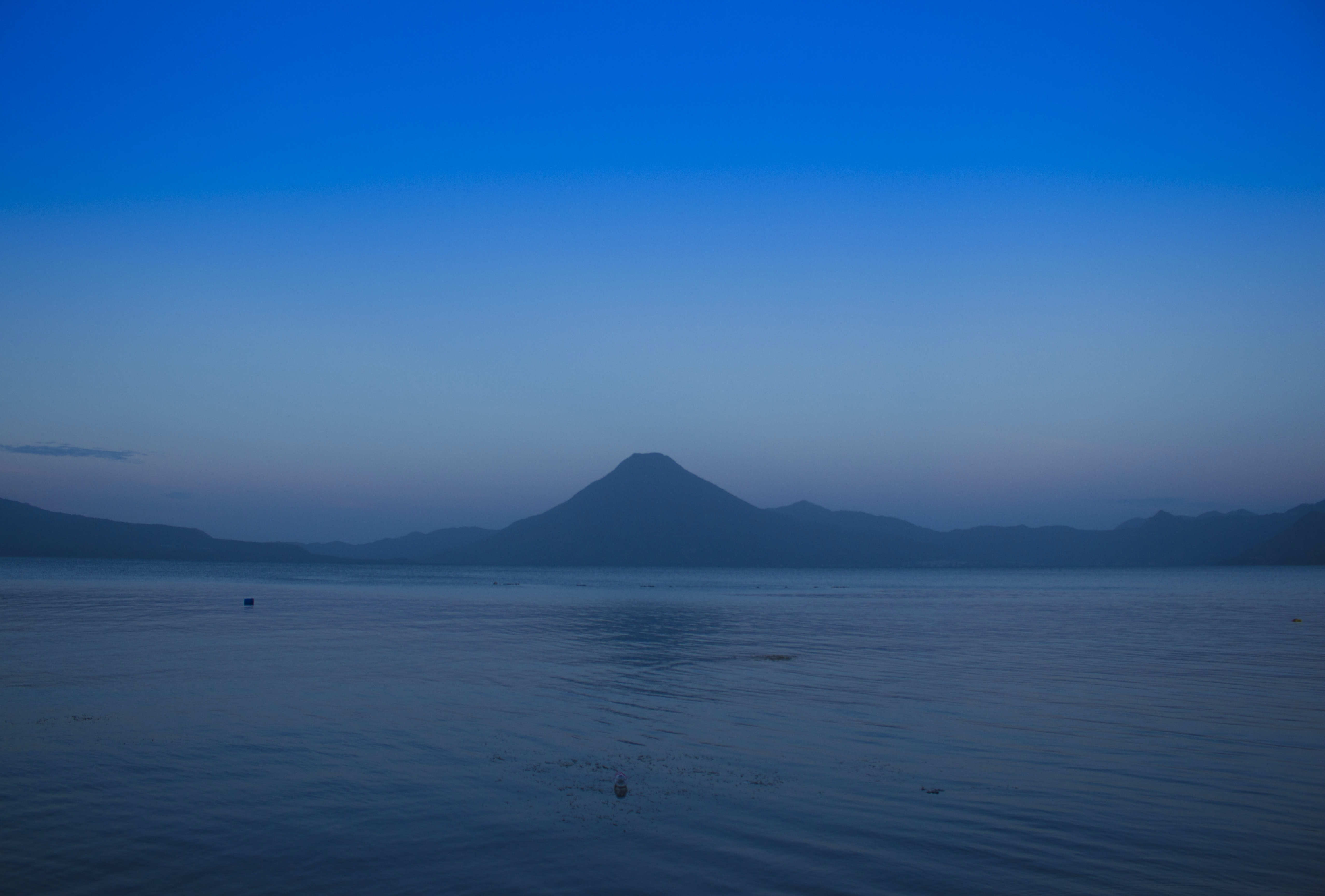 silhouette of mountains between sea and sky