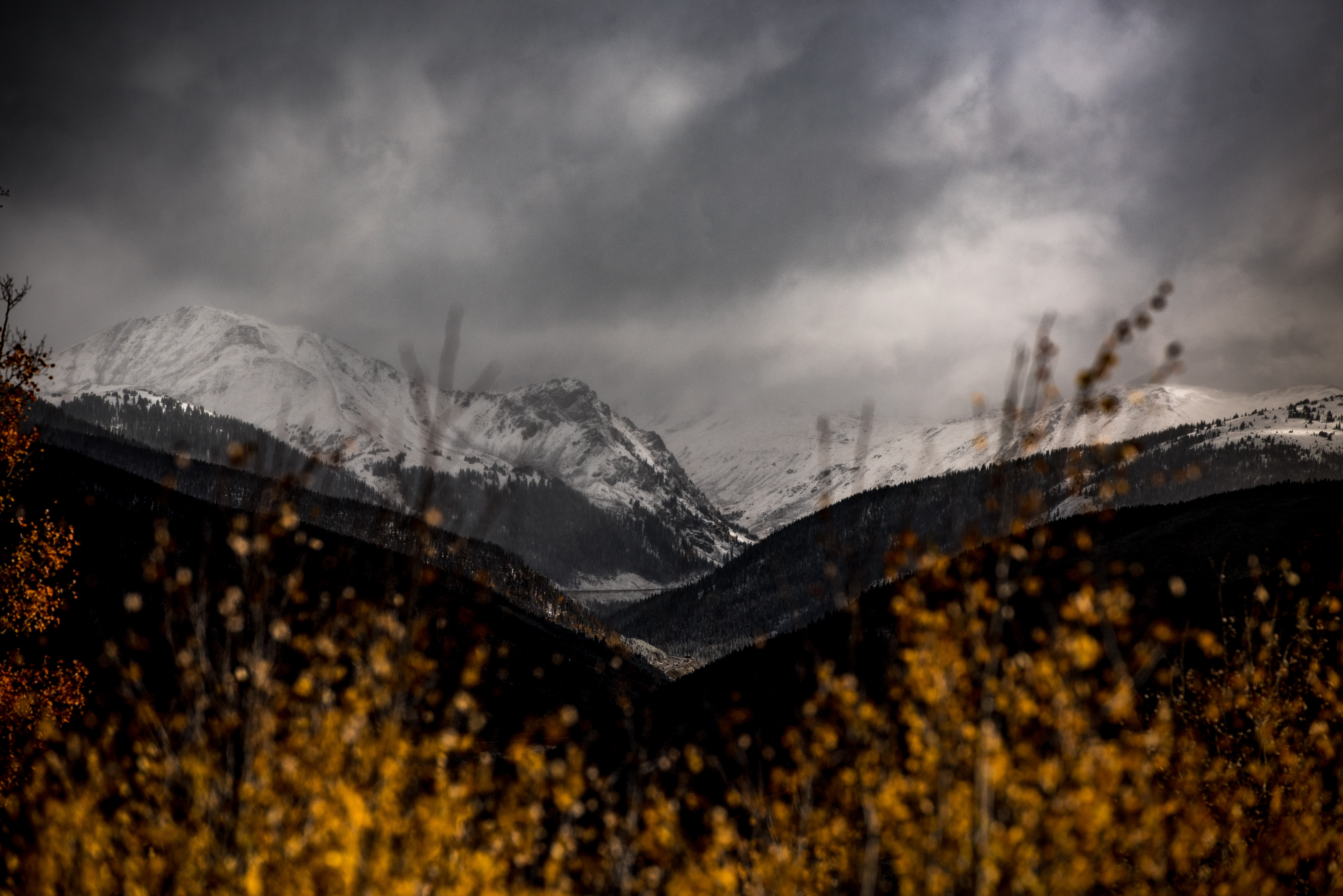 snow mountain covered by dark clouds