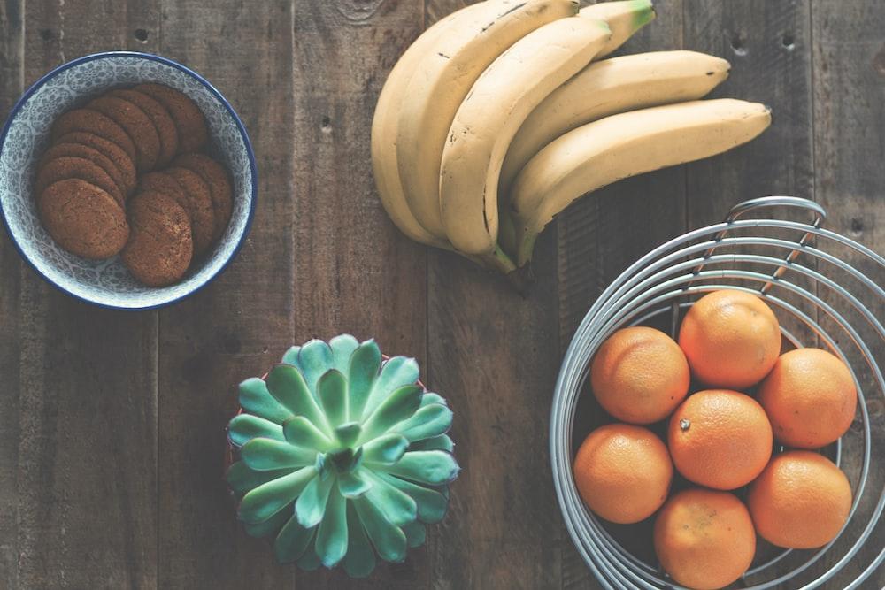 ripe banana fruit beside stainless steel fruit rack