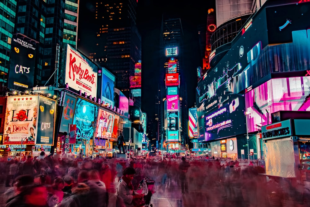 time lapse photography of crowd of people on new york time square during night time