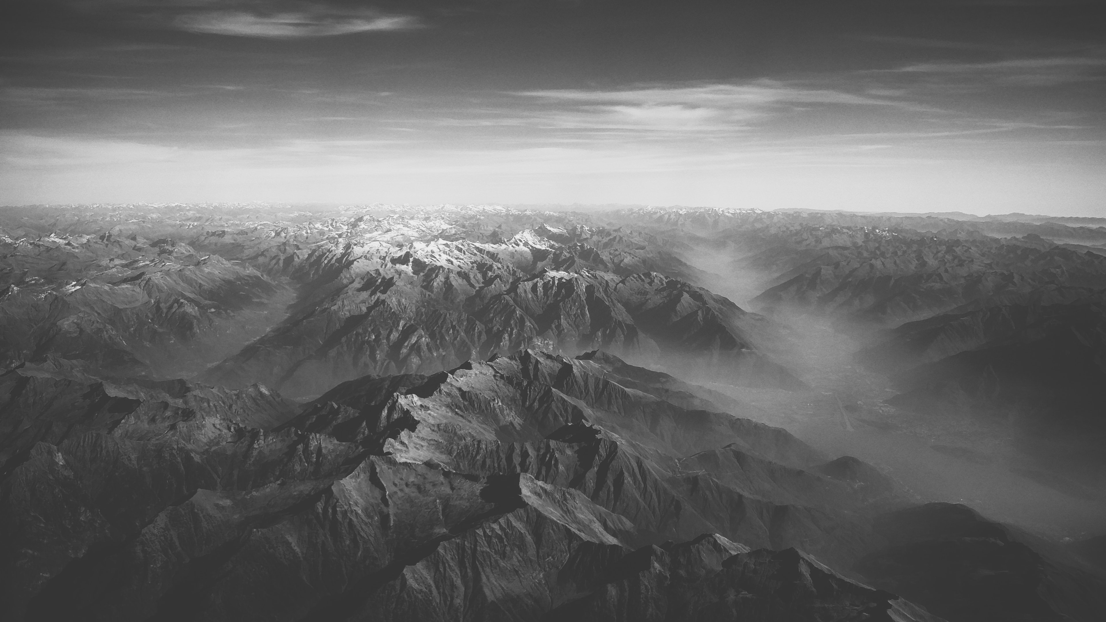 A black-and-white shot of a vast mountainous area