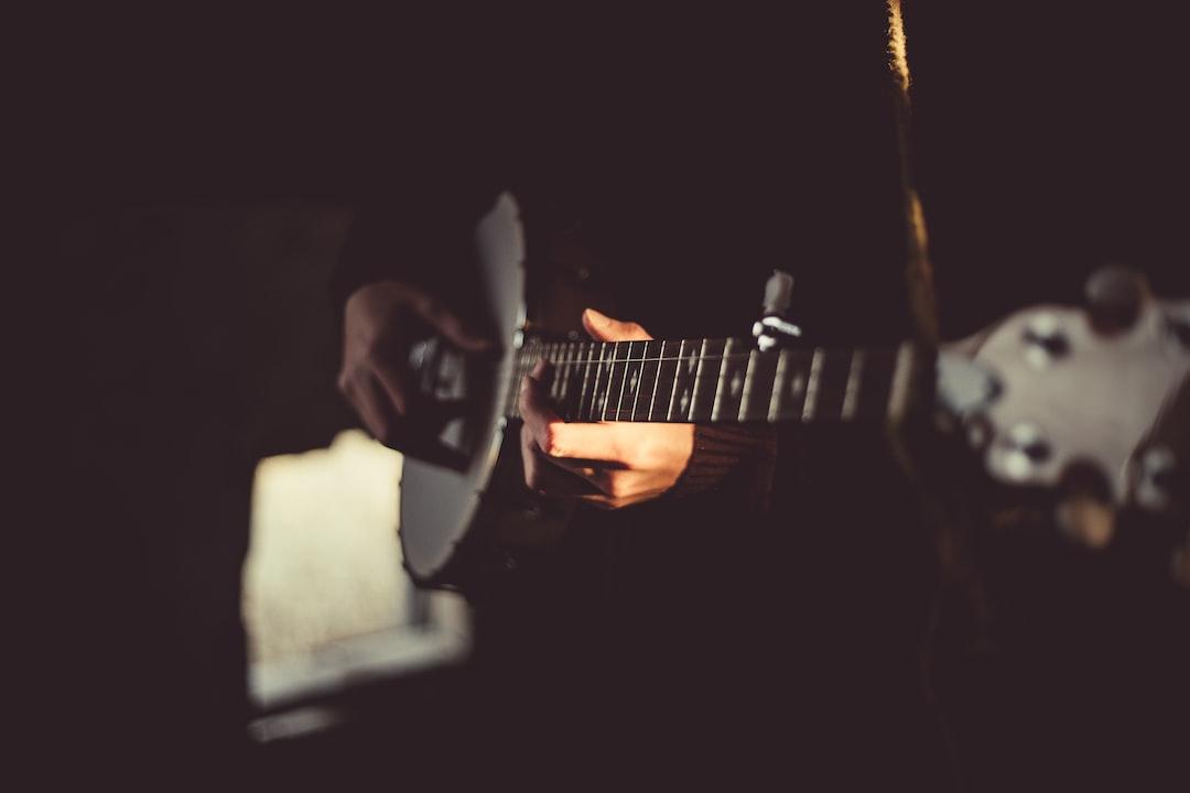Banjo player in a dark room