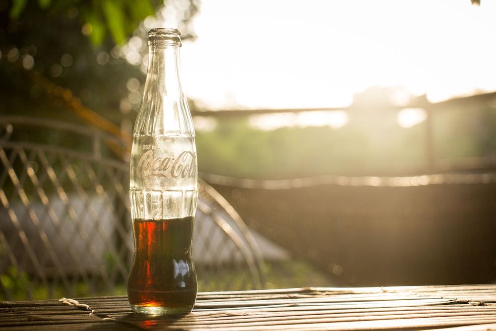 selective photo of a Coca-Cola bottle