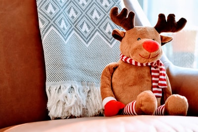 brown deer plush toy xma zoom background
